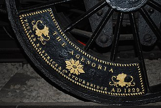 Agenoria (locomotive) - The unusual maker's plate, forming a balance weight on the driving wheel