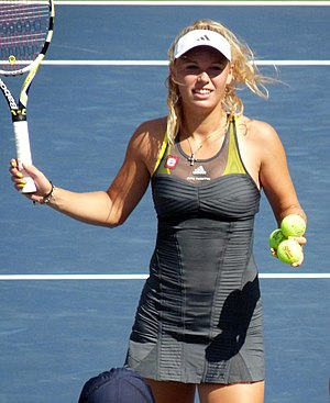 "Stella McCartney - ""Stella McCartney"" reads beneath the Adidas logo on this dress worn by Caroline Wozniacki at the 2010 US Open."
