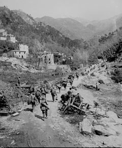 The 370th Regiment advances through Prato, Italy.