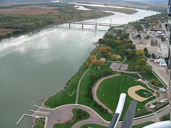 Yankton (right) along the Missouri River with the Meridian Bridge connecting Nebraska, looking west.