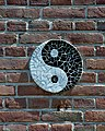 Yin-yang symbol on the side of a house in Amsterdam (9256281925).jpg