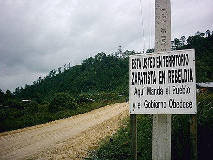"Sign at the entrance to one of the communities under the control of the Ejército Zapatista de Liberación Nacional. The sign reads, ""You are in Zapatista territory in rebellion, here the people command and government obeys."" Zapatista sign.jpg"