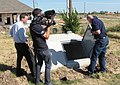 """""""Moore, Okla., October 3, 2013 -- FEMA mitigation expert John Bourdeau (r) demonstrates a partially underground safe room for a two-part television news report on residential safe r - DPLA - facdeb836fa0d2eddbce281b634d6824.jpg"""