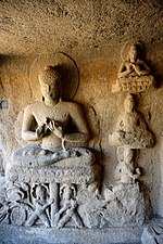 052 Cave 15, Buddha on Lotus Throne (33811678612).jpg