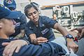 150413-N-XM324-040 - PO3 Christina Casillas applies a splint to a simulated broken arm aboard USS Fitzgerald.jpg