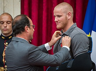Spencer Stone - French President François Hollande pins the Legion of Honor on Stone during a ceremony at the Élysée in Paris on August 24, 2015.