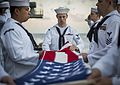 170117-N-BL637-057 - Sailors participate in a burial at sea ceremony.jpg