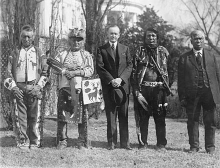 Osage men with Coolidge after he signed the bill granting Native Americans U.S. citizenship 1924 Indian Citizenship Act.jpg