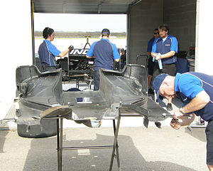 Downforce - The CFRP floor of the Panoz DP01 ChampCar exhibiting complex aerodynamic design.