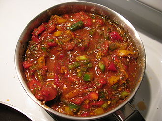 Tomato sauce - A tomato-based sauce containing tomato puree, diced tomatoes, and bell peppers (red, yellow, and green), with the seeds included. It is seasoned with fresh garlic, basil, oregano, paprika, cajun seasoning, crushed red pepper, parsley, olive oil, and possibly some additional seasonings.
