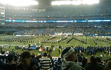 University of Connecticut marching band on the Rogers Centre field, in a formation spelling out U C O N N
