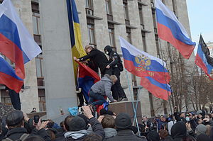 Timeline of the 2014 pro-Russian unrest in Ukraine - Pro-Russian protesters remove a Ukrainian flag and replace it with a Russian flag in front of the Donetsk Oblast Regional State Administration building, 1 March 2014