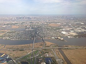2014-05-07 16 23 15 View of New York City, Secaucus, New Jersey, the Hackensack River, the New Jersey Turnpike Western Spur and New Jersey Route 3 from an airplane heading for Newark Liberty International Airport.JPG