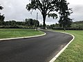 2018-09-10 15 00 25 View south along the road through Finn's Point National Cemetery, the westernmost road in New Jersey, in Pennsville Township, Salem County, New Jersey.jpg