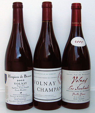 Volnay wine - Three bottles of Volnay Premier Cru. The left-hand bottle is a named cuvée which does not mention a specific vineyard, the bottle in the middle is from the Champans vineyard, and the right-hand bottle is from Volnay-Santenots, a vineyard in the commune of Meursault.