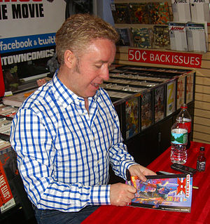 Ultimate X-Men - Writer Mark Millar signing a copy of the first issue during an appearance at Midtown Comics in Manhattan.