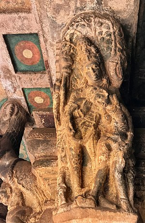 Badami cave temples - Artwork shows a collapsing sorrowful woman being helped.