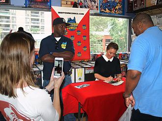 Periscope (app) - As actress Alyssa Milano autographs copies of her graphic novel during an appearance at Midtown Comics in Manhattan, her assistant, Kelly Kall (left foreground) streams video of the event on Periscope.