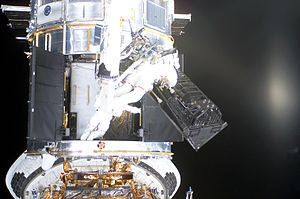 Advanced Camera for Surveys - Astronauts remove the FOC to make room for the ACS, Year : 2002