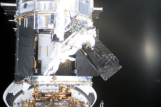 STS-109 - Astronauts remove the FOC to make room for the ACS
