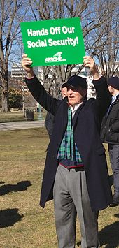 AFSCME supporter holding sign over his head - Hands Off Our Social Security.jpg