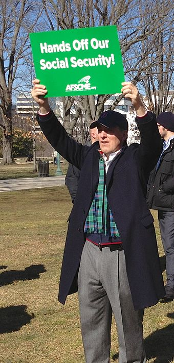 AFSCME supporter holding sign over his head - Hands Off Our Social Security., From WikimediaPhotos