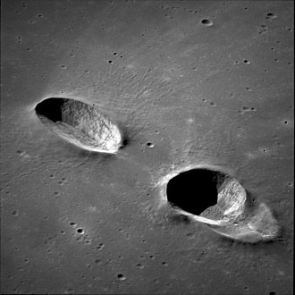 Messier (crater) - Messier (left) and Messier A (right) from Apollo 11. NASA photo.