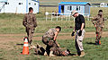 A Mongolian service member participates in a pepper spray qualification course during Non-Lethal Weapons Executive Seminar (NOLES) 13 at Five Hills Training Area, Mongolia, Aug. 21, 2013 130821-M-DR618-115.jpg