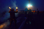 A Sailor directs an FA-18C at night2.jpg