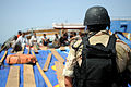 A U.S. Navy visit, board, search and seizure team member guards the crew aboard a dhow during a boarding operation near guided-missile cruiser USS Anzio (CG 68) Sept 090908-N-ZL677-140.jpg