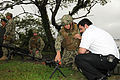 A U.S. Sailors shows an M240 machine gun to a Chilean sailor, with the Chilean Naval War College, during a tour of Navy Expeditionary Combat Command at Joint Expeditionary Base Little Creek-Fort Story, Va 120808-N-ZQ794-042.jpg