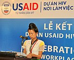 A beneficiary of USAID HIV Workplace Project, who belongs to Thai ethnic minority group and lives in Dien Bien province, tells her story at the event. (9092283630).jpg