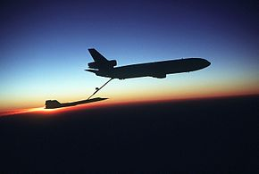 A right side view of a KC-10 Extender aircraft refueling an SR-71 Blackbird aircraft in-flight during testing DF-ST-83-03355.jpg