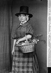 A woman in national dress with a basket of flowers (Vaughan)