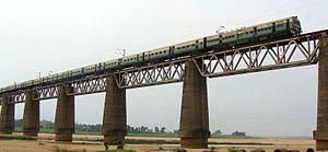 Asansol–Tatanagar–Kharagpur line - A MEMU train travelling on the bridge across Damodar River