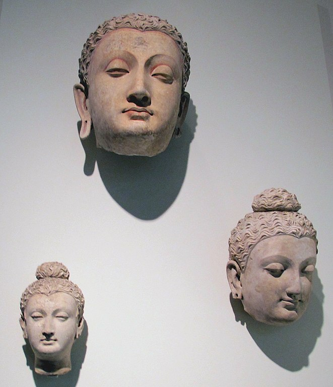 Three plaster heads of the Buddha from Hadda, Afghanistan
