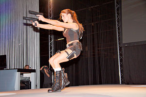 Dual wield - Model dressed as Lara Croft dual wielding pistols