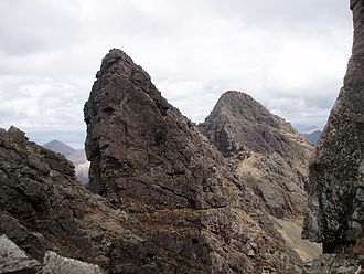 Am Basteir - The vertical west face of Am Basteir, with Sgùrr nan Gillean in the background