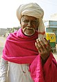An old man voter showing mark of indelible ink after casting his vote, at a polling booth, during the 2nd phase of Gujarat Assembly Election, in Gandhinagar, Gujarat on December 14, 2017.jpg