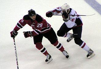 Donald Brashear - Brashear (right) delivering a cross-check to the New Jersey Devils' Anssi Salmela