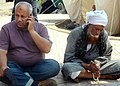 Anti-coup protesters sitting outside Rabaa al-Adawiya mosque Cairo 11-July-2013.jpg