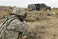 Army Sgt. David Evans, a platoon sergeant, with 256th Signal Company, confronts the occupants of a suspicious van, that came from the same direction as a simulated attack on the tactical operations center 121111-A-DM007-449.jpg