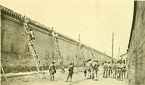 Manchu Restoration - Republican troops scaling the wall of the Forbidden City.