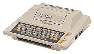 Atari 8-bit family - Atari 400 (1979).  Featuring a membrane keyboard and single-width cartridge slot cover.