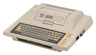 Atari 8-bit family - Atari 400 (1979).  Featuring a membrane keyboard and single-width cartridge slot cover.