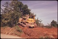 BULLDOZER IS USED BY THE COAL COMPANIES TO CLEAR TREES TO READY THE LAND FOR STRIP MINING. OFF ROUTE ^800 NEAR... - NARA - 555601.tif