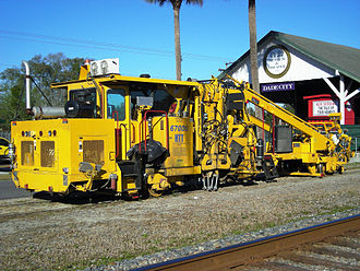 Work train - Ballast tamping machine as used in railroad track maintenance in Florida
