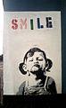 Banksy Smile Girl Aug2013.jpg