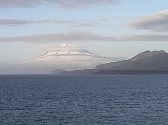 Jan Mayen - Snow-covered Beerenberg beyond coastal hills