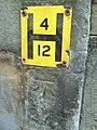 Benchmark below hydrant sign on Merton College Chapel - geograph.org.uk - 2045810.jpg